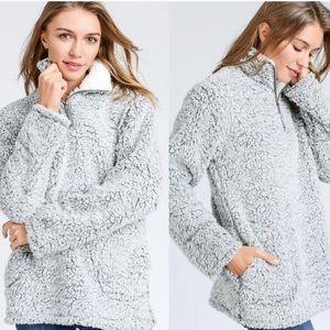 Sherpa pullover with zipper and pockets
